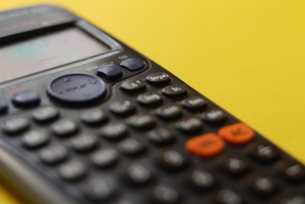 Calculator on a yellow background.