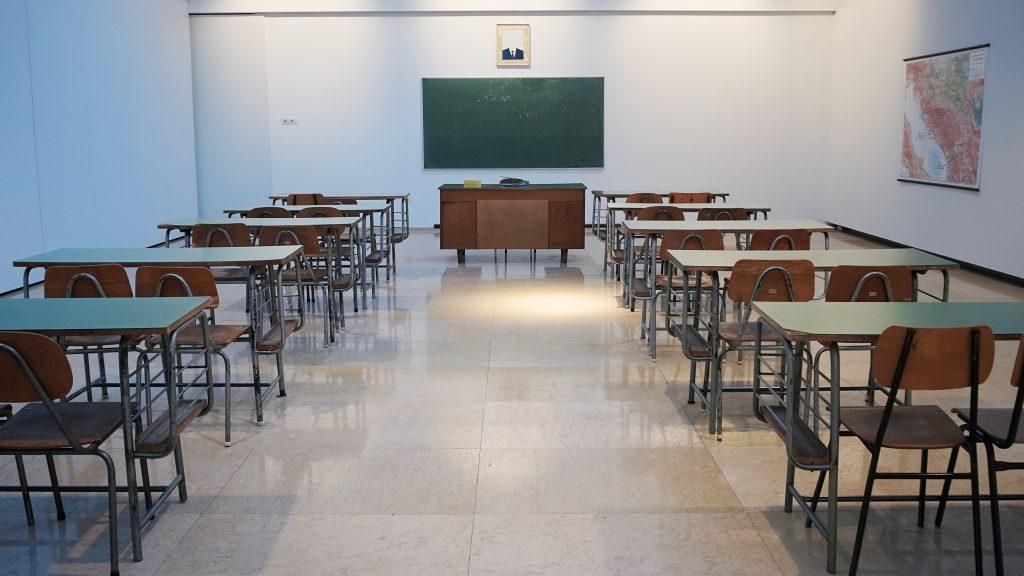 Empty classroom with empty desks.